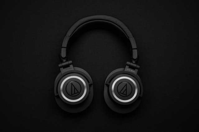 top view photo of black wireless headphones 1649771