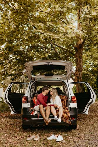 Couple Sitting In the Back of Car